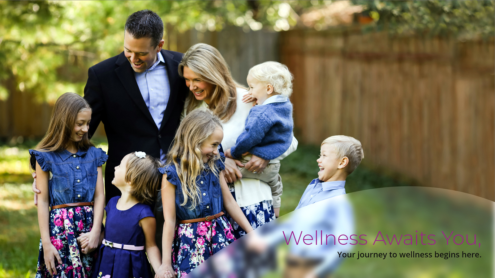 Banner for Newhouse Health Solutions featuring Dr. Patrick Newhouse, B.S, D.C. with his family in a spacious backyard area. The text on the bottom of the image reads 'Wellness Awaits You. Your journey to wellness begins here.'